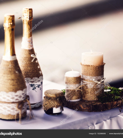 wedding bottles, jars and candles in rustic style, decorated with bagging, lace, moss.